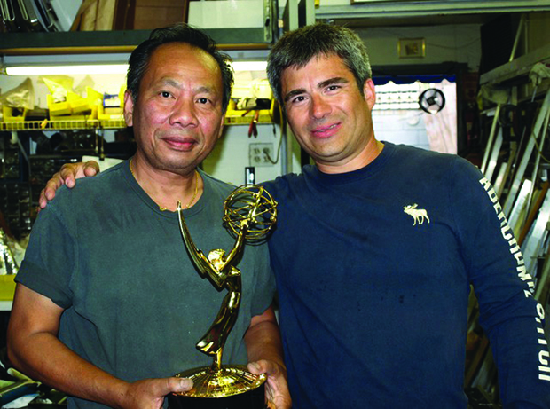 After the Emmy ceremonies, Henry Embry brought his statuette to the shop to share the win with Chinhda. Photo by David Waelder